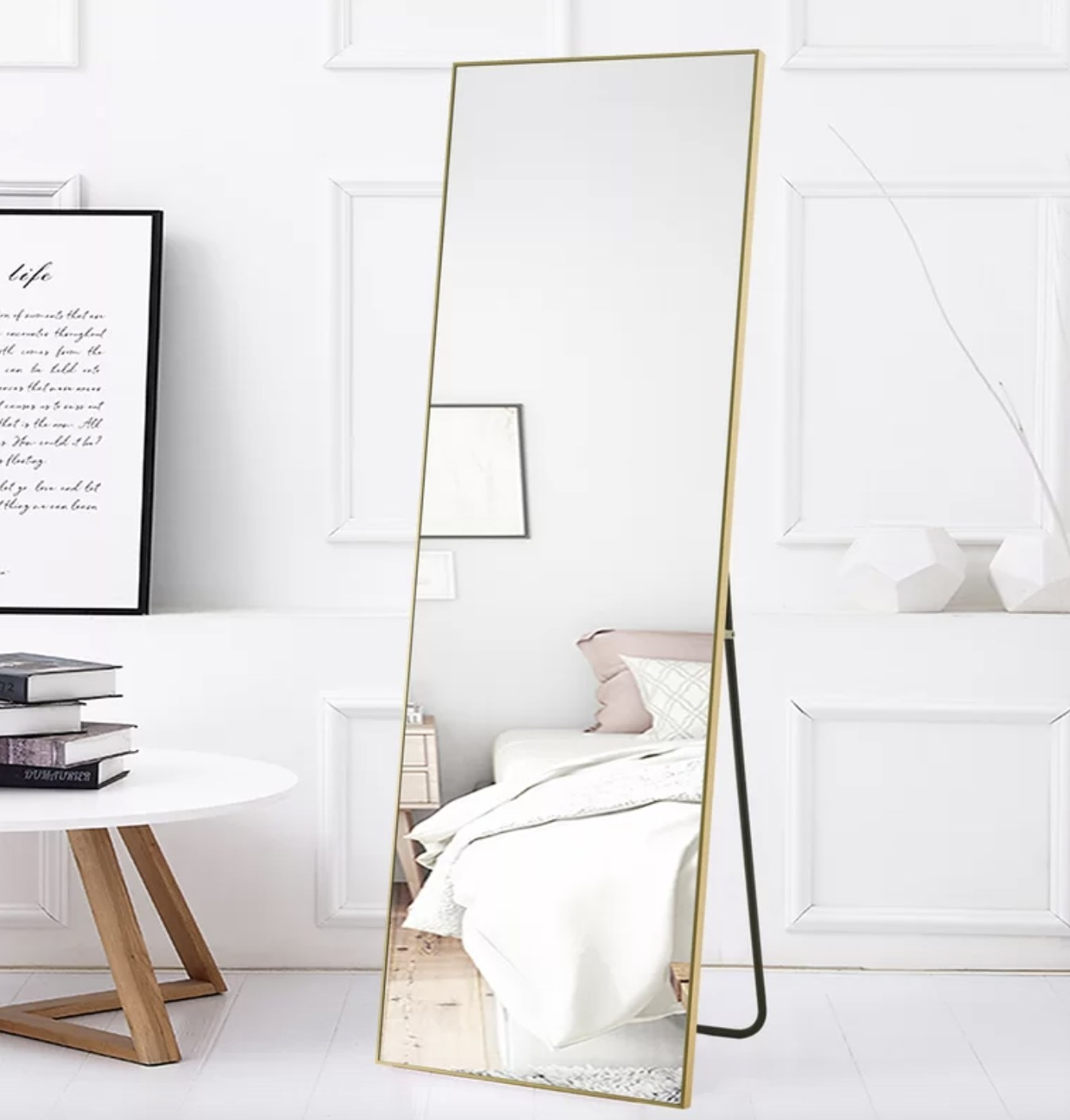 the mirror with gold accents