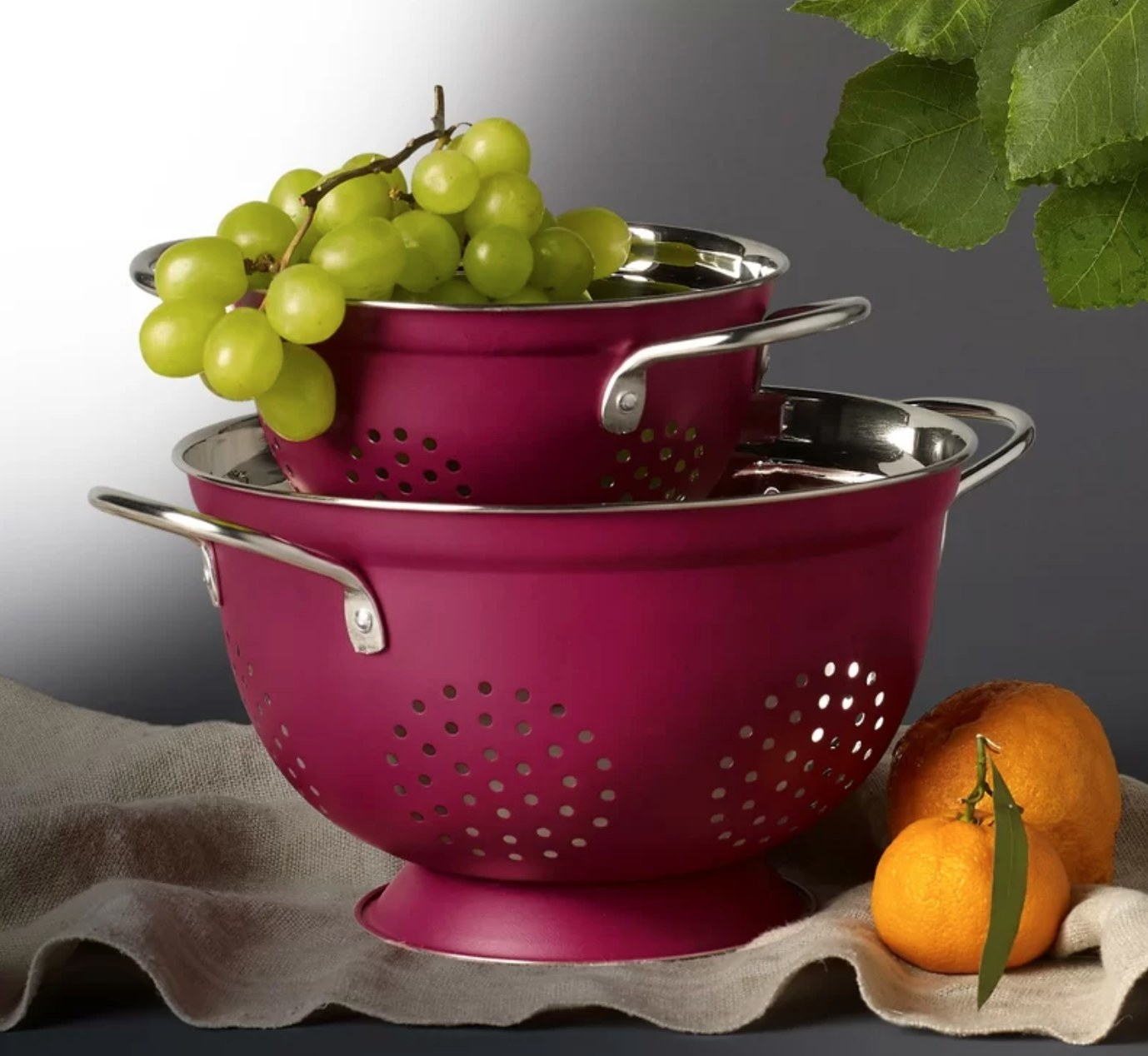 The two-piece set of stainless steel colanders in pink