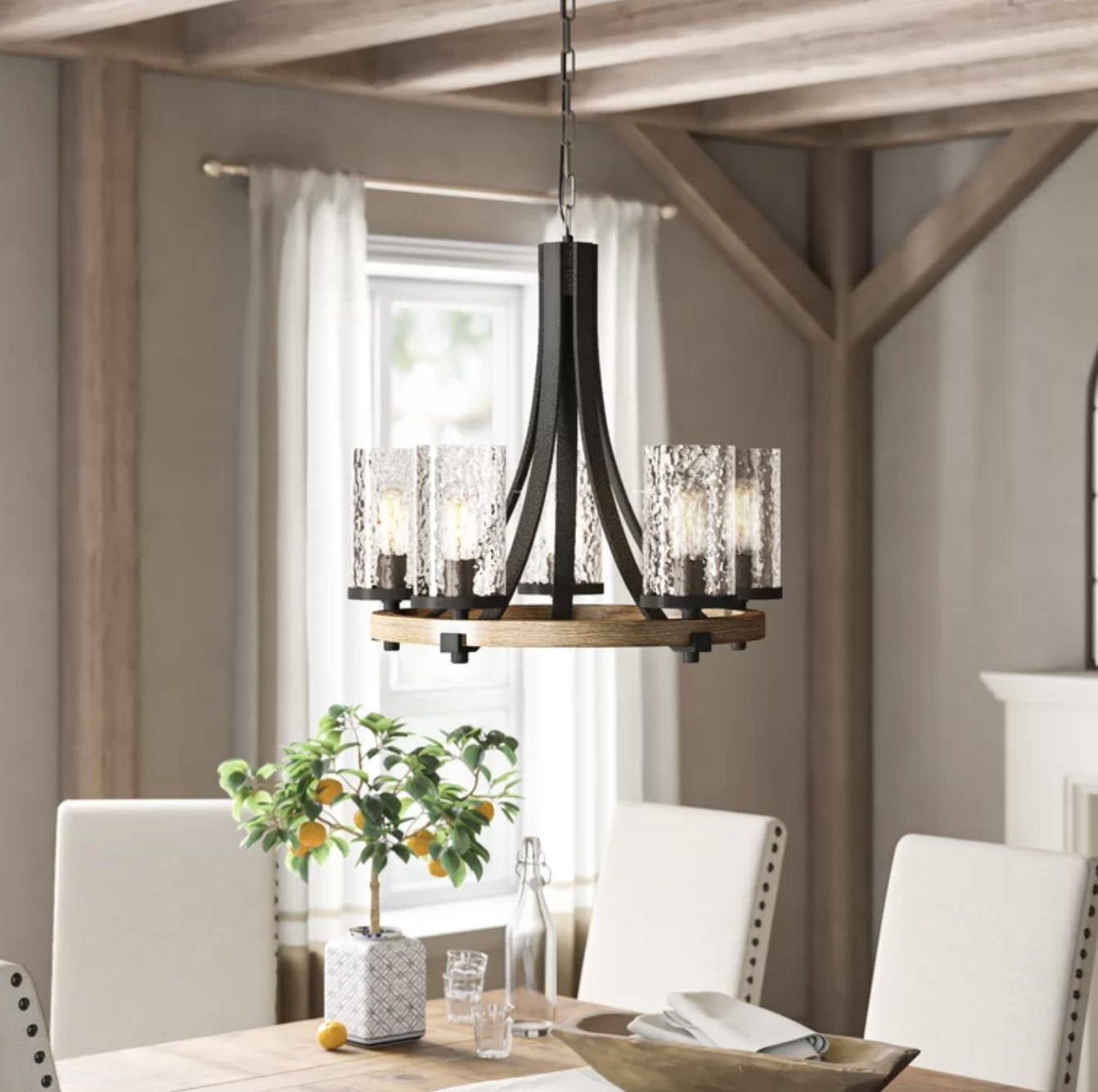 the chandelier with glass light shades and a wooden base