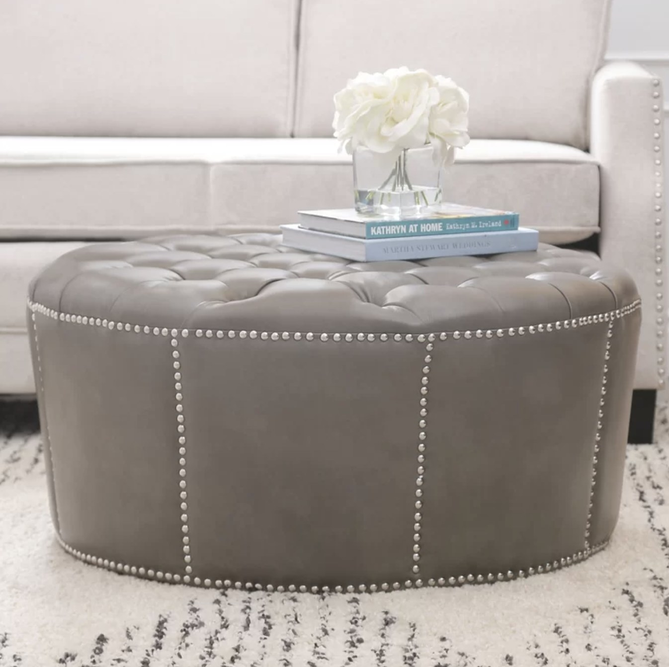 the ottoman in gray with silver detailing