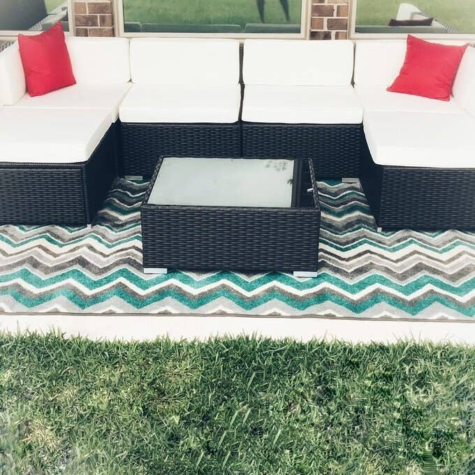 the sectional in white in a reviewer's backyard