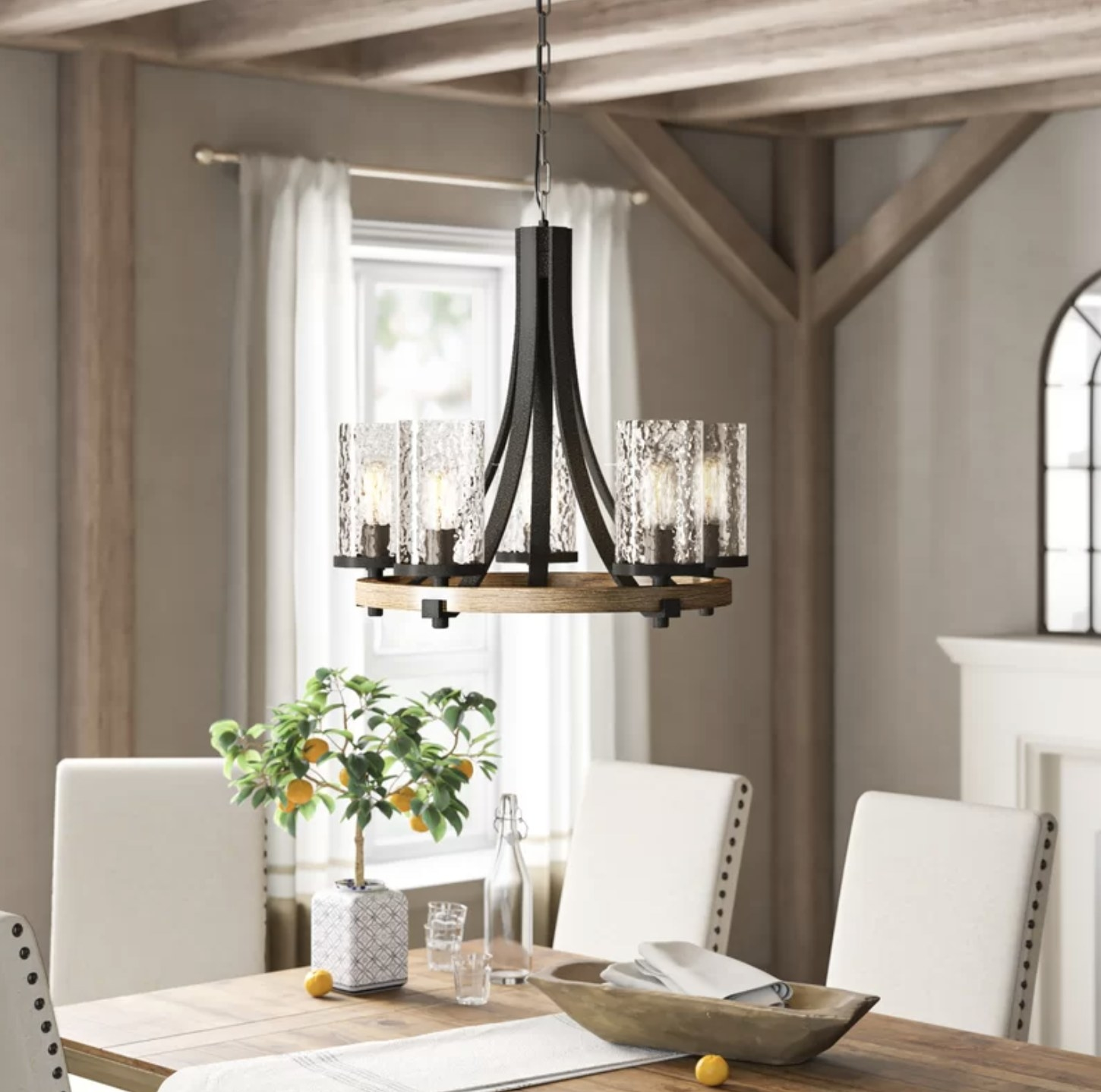 The chandelier above a dining room table