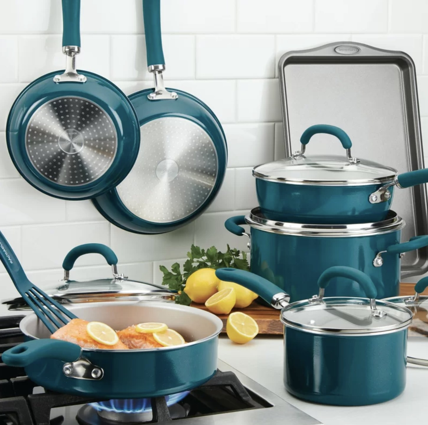 The cookware set on a dark teal color