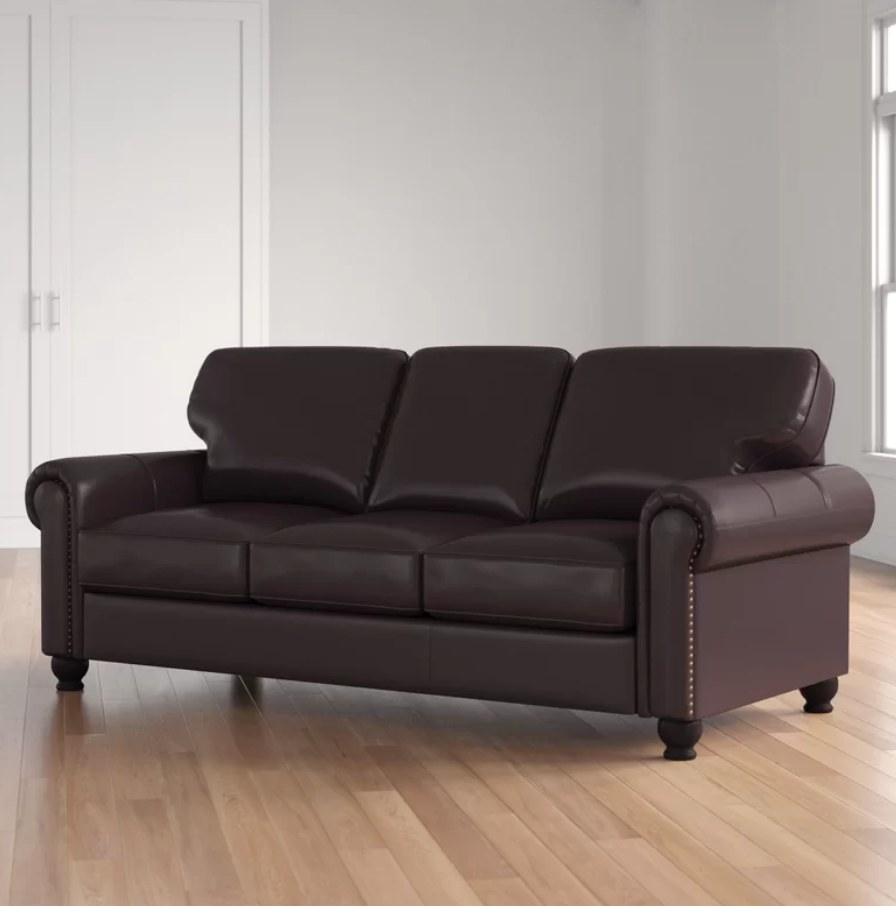 A brown leather sofa with removable back cushions