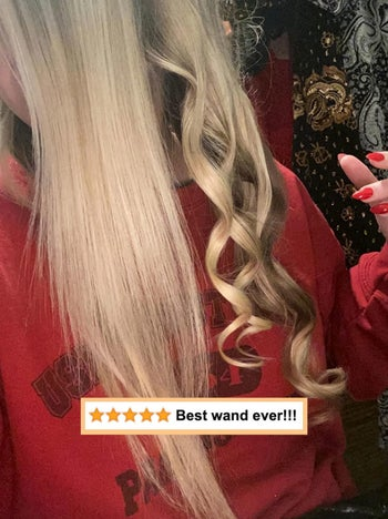 reviewer photo of a section of straight hair and another completely curled with wand