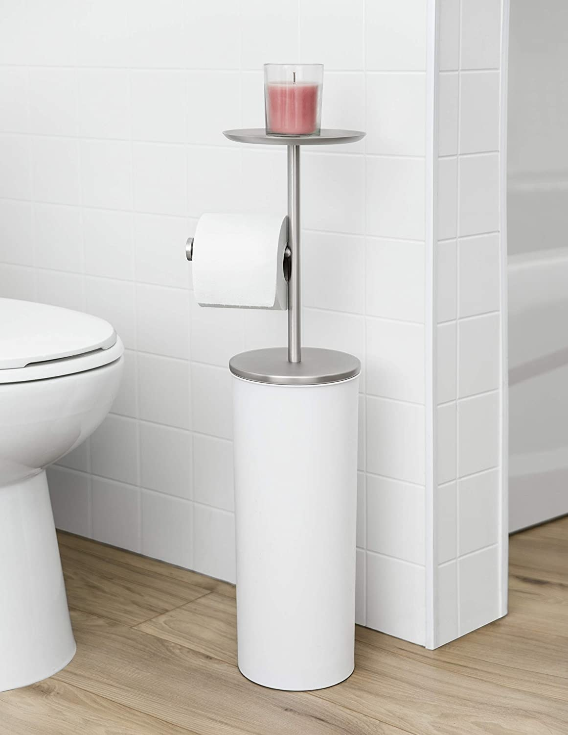 A toilet paper stand with several perches for toilet paper, phones, and candles