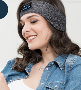 Model wearing wraparound grey fabric headband headphones
