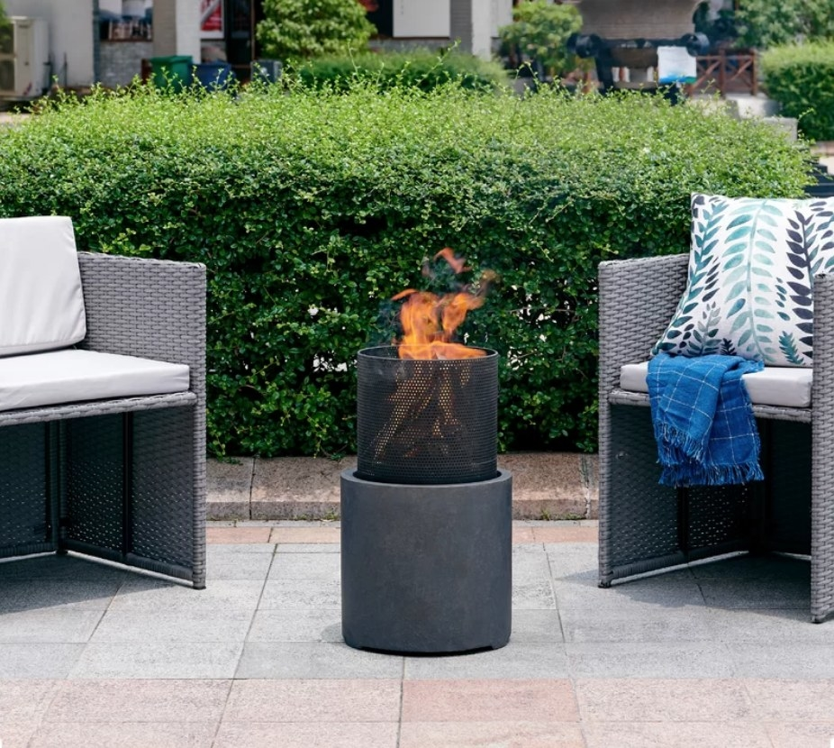Rounded fire pit in between two chairs
