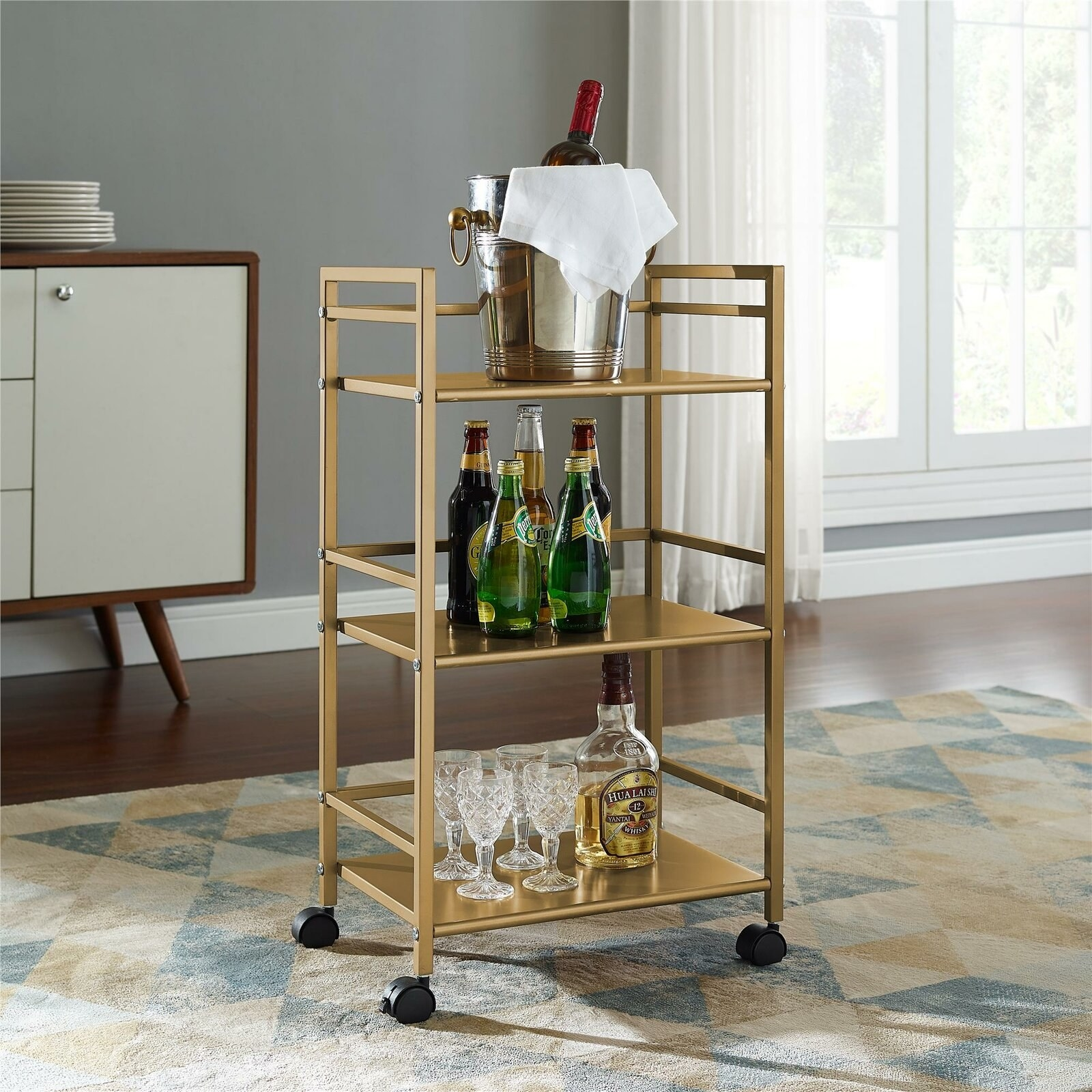 the bar cart, which has wheels and three levels of shelving