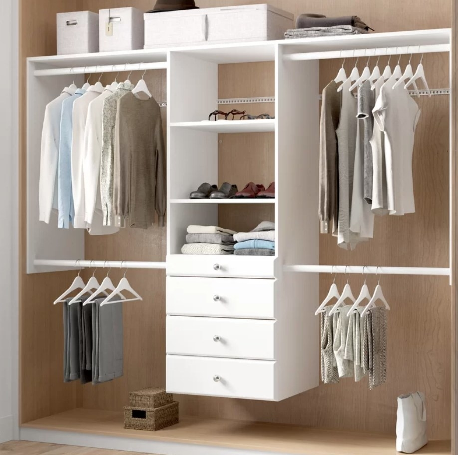 White closet system with drawers/shelves n the middle, hanger racks on top and bottom on either side
