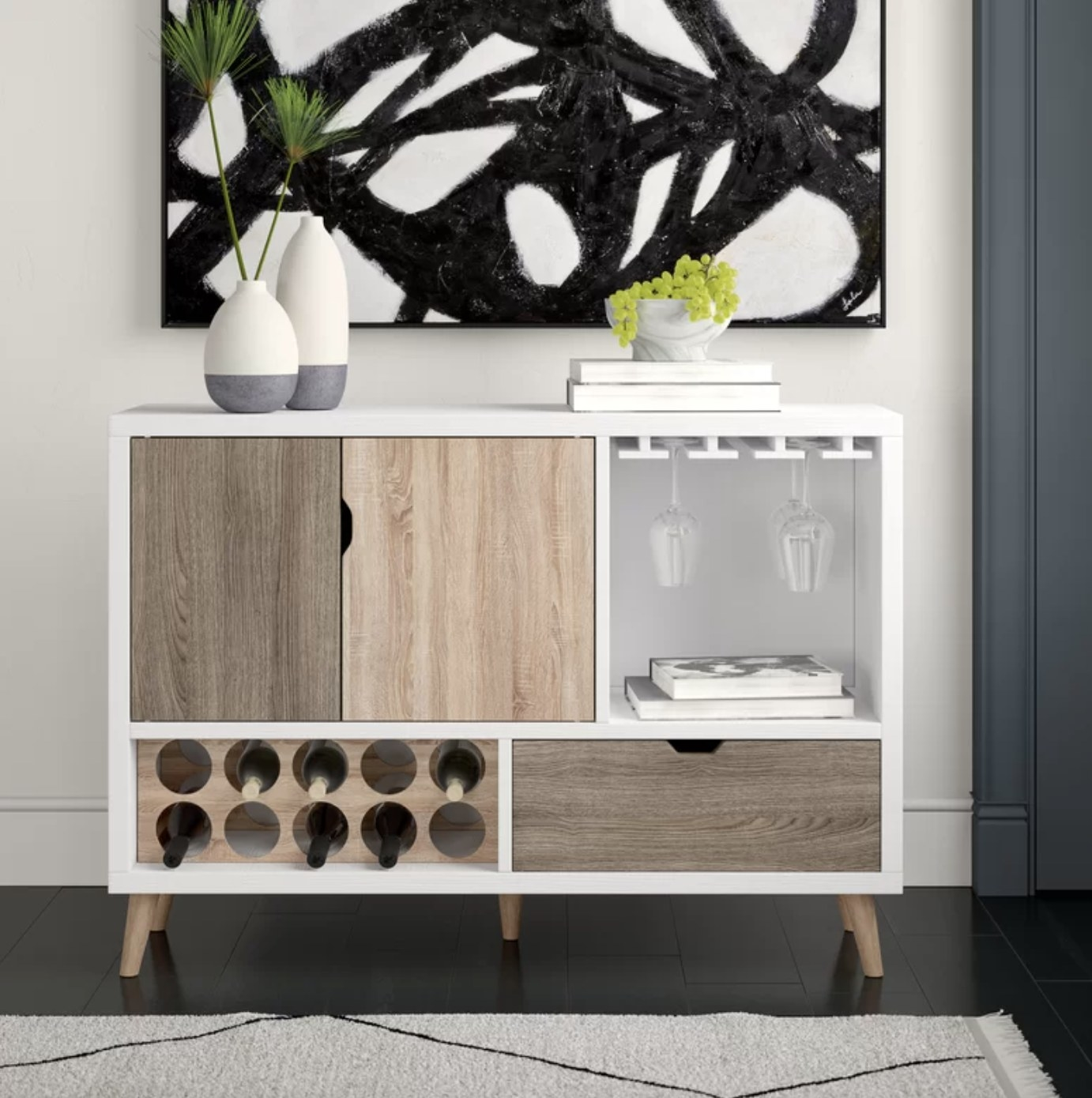 the shelving unit with wine bottle and glass storage