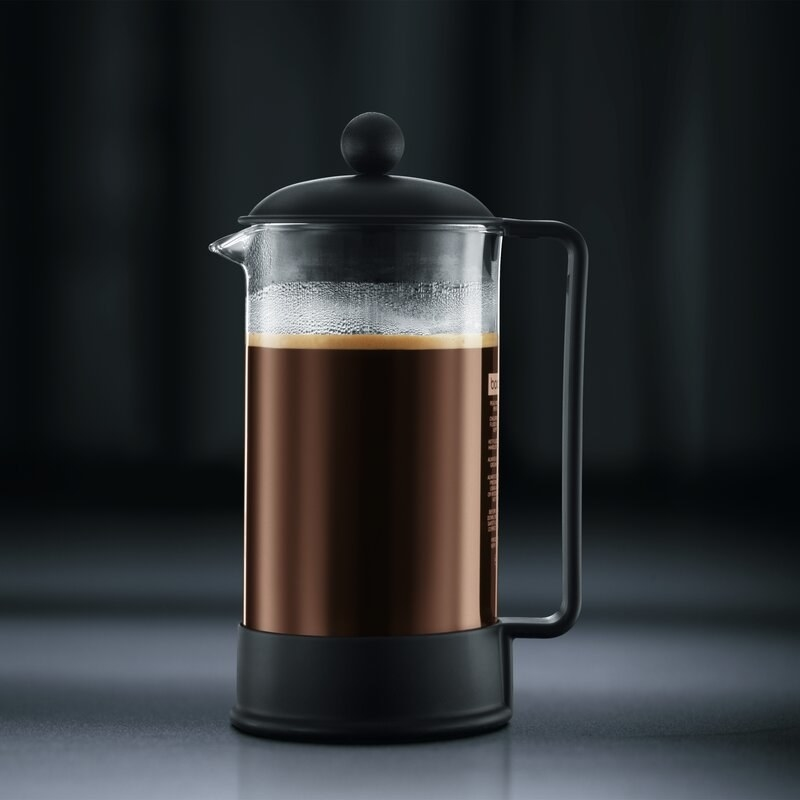 the french press against a gradient black background