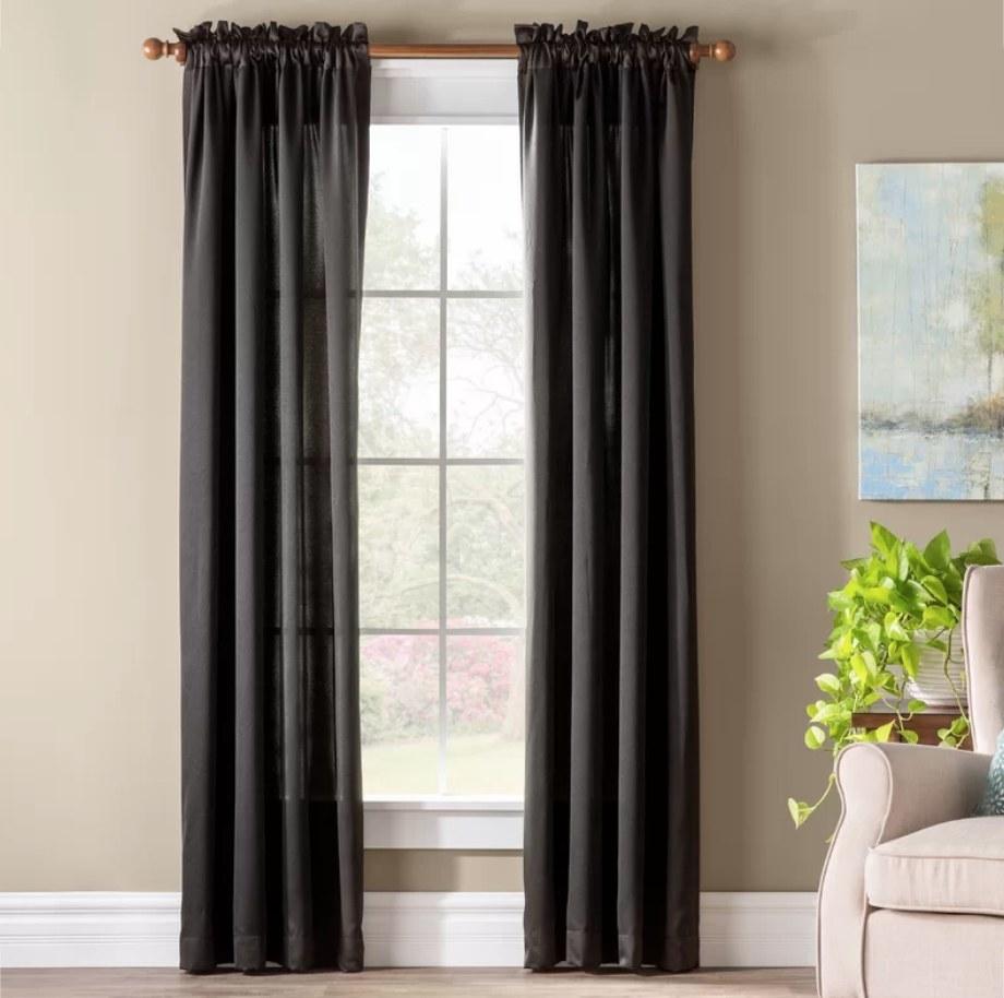 Black curtains on window