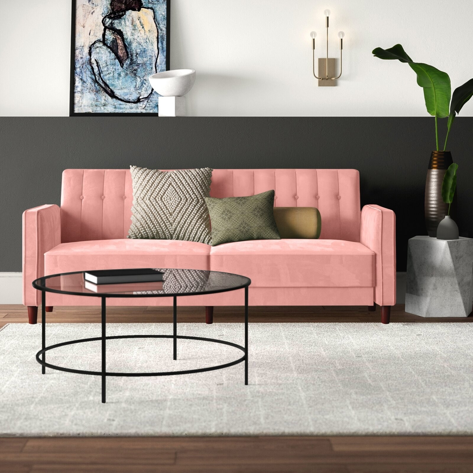 The couch, which has square arms and back, in pink