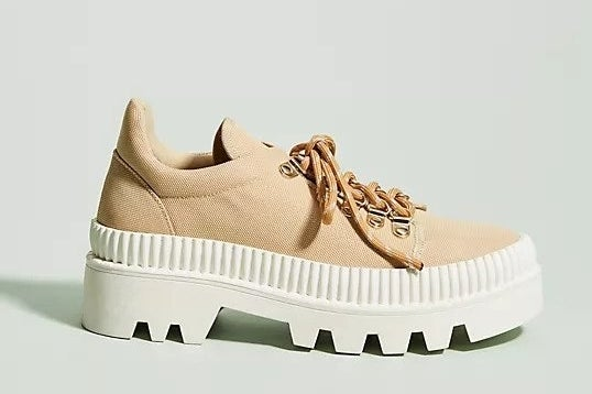 High sneaker with extra chunky sole, a strong tongue and heel, and boot-like laces with metal hook details