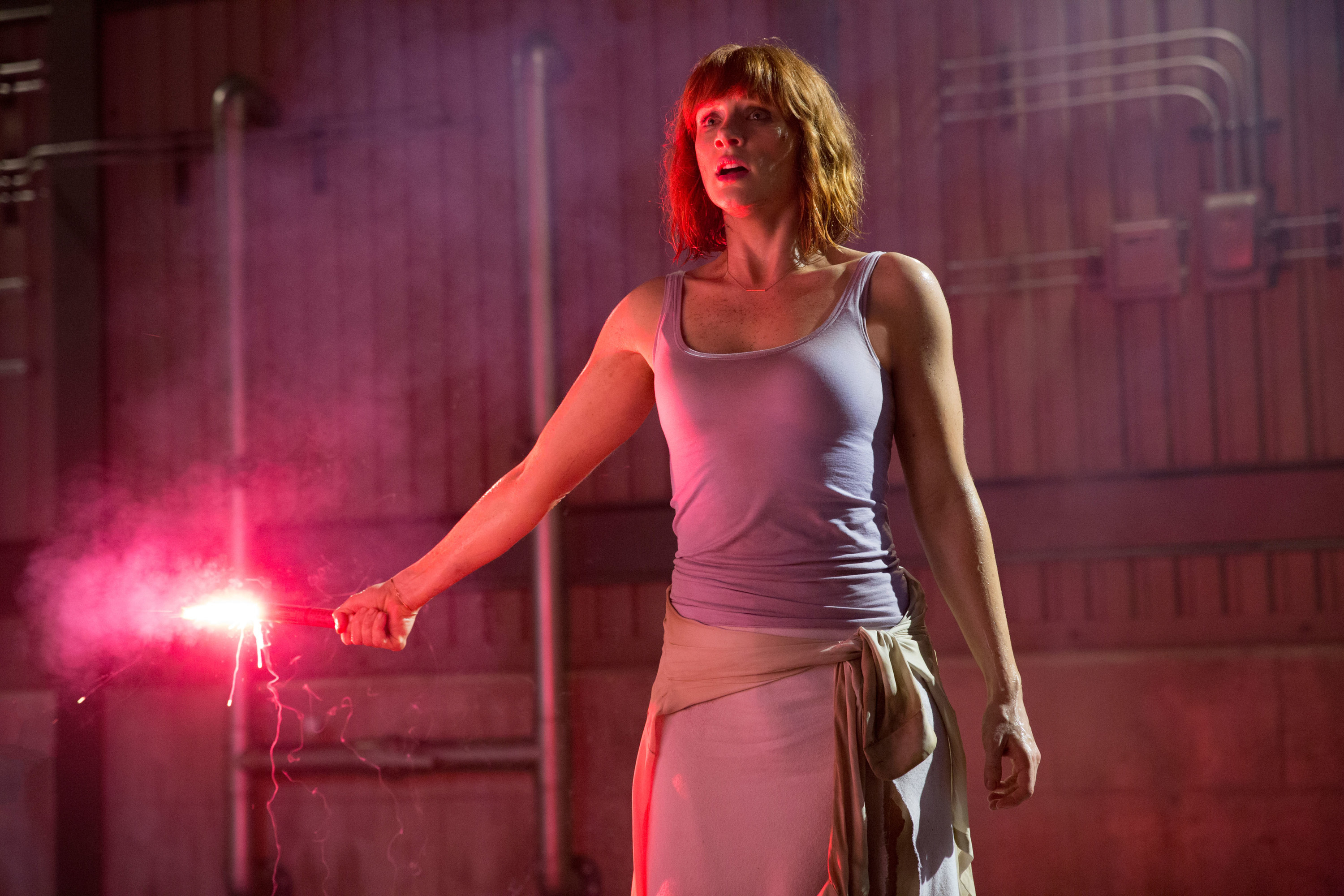 Bryce Dallas Howard holds a flare in Jurassic World