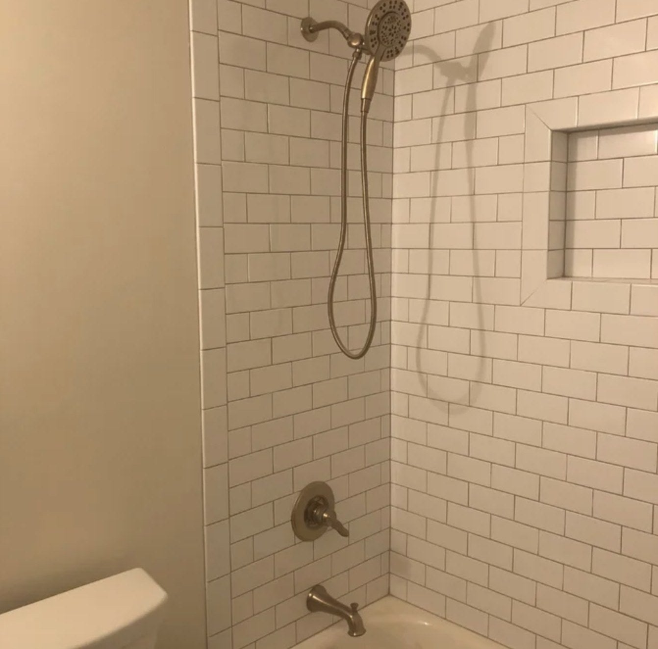 the showerhead in a reviewer's shower