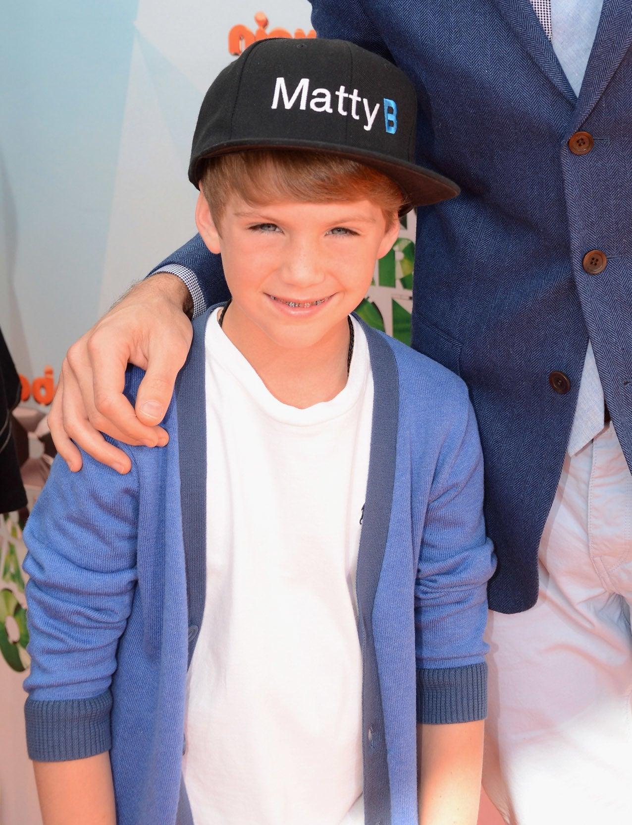 """Matty B wearing a baseball cap that says """"Matty B"""""""