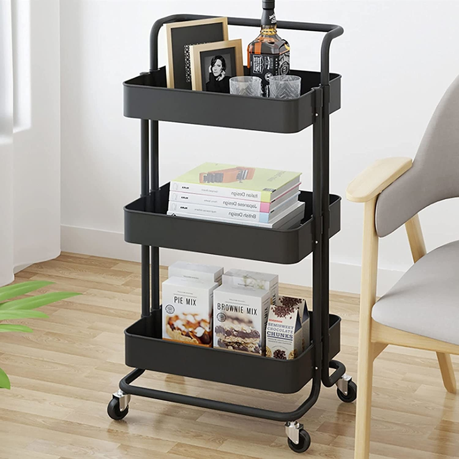 The rolling utility cart with books and various knick knacks on it
