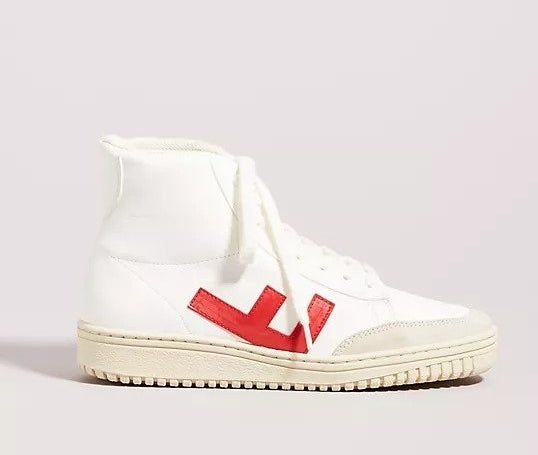 """White hightop sneaker with embroidered letter """"F"""" upside down on the side of the shoe"""