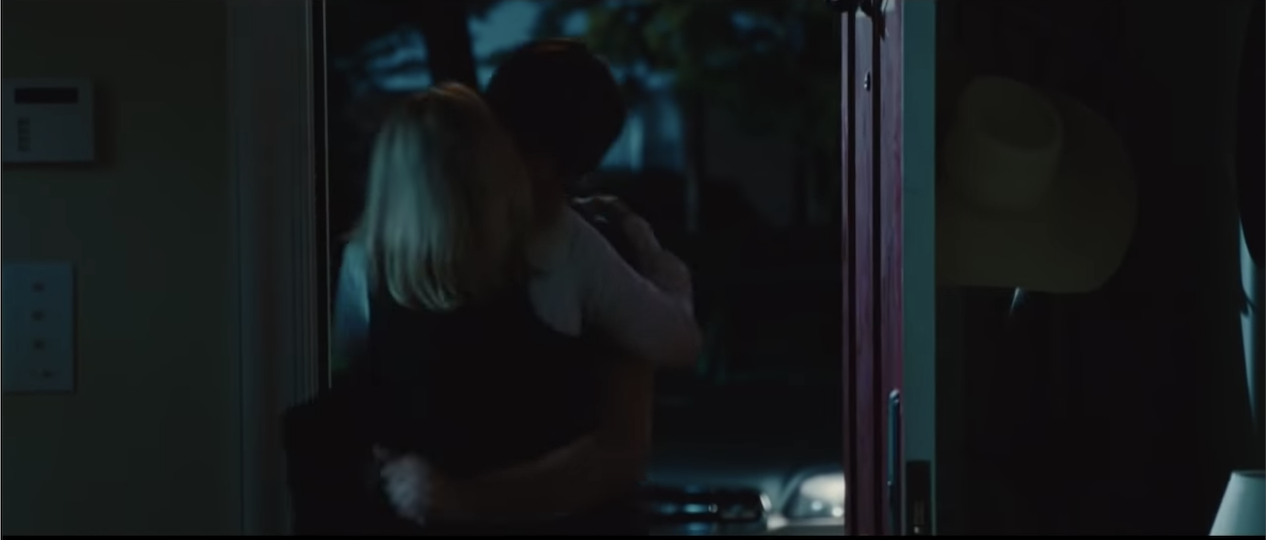 A couple makes out as they enter a house