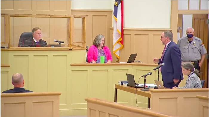Tadych stands to speak to the judge in a courtroom
