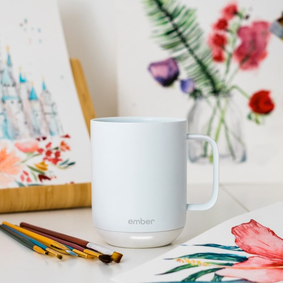 The mug surrounded by art supplies