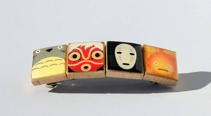 the rectangular barrette made from four tiles painted with Totoro, the Princess Mononoke mask, No Face, and Calcifer