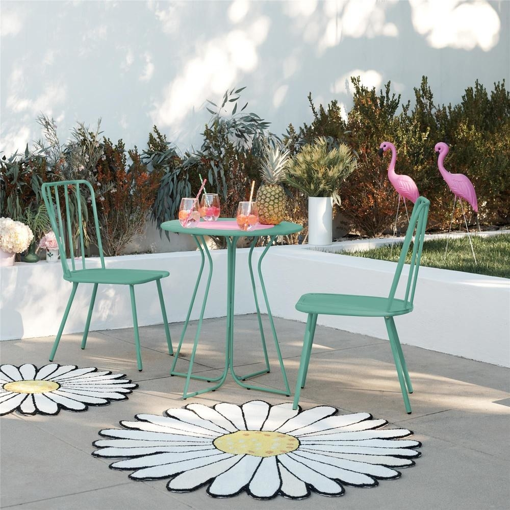 two teal dining chairs and a matching circle table