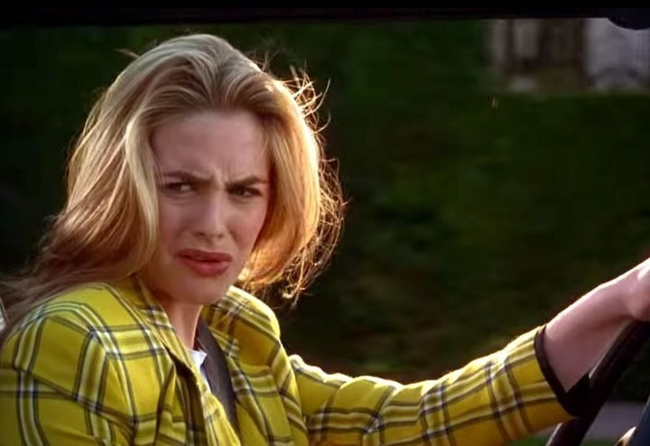Cher from clueless making a disgusted face