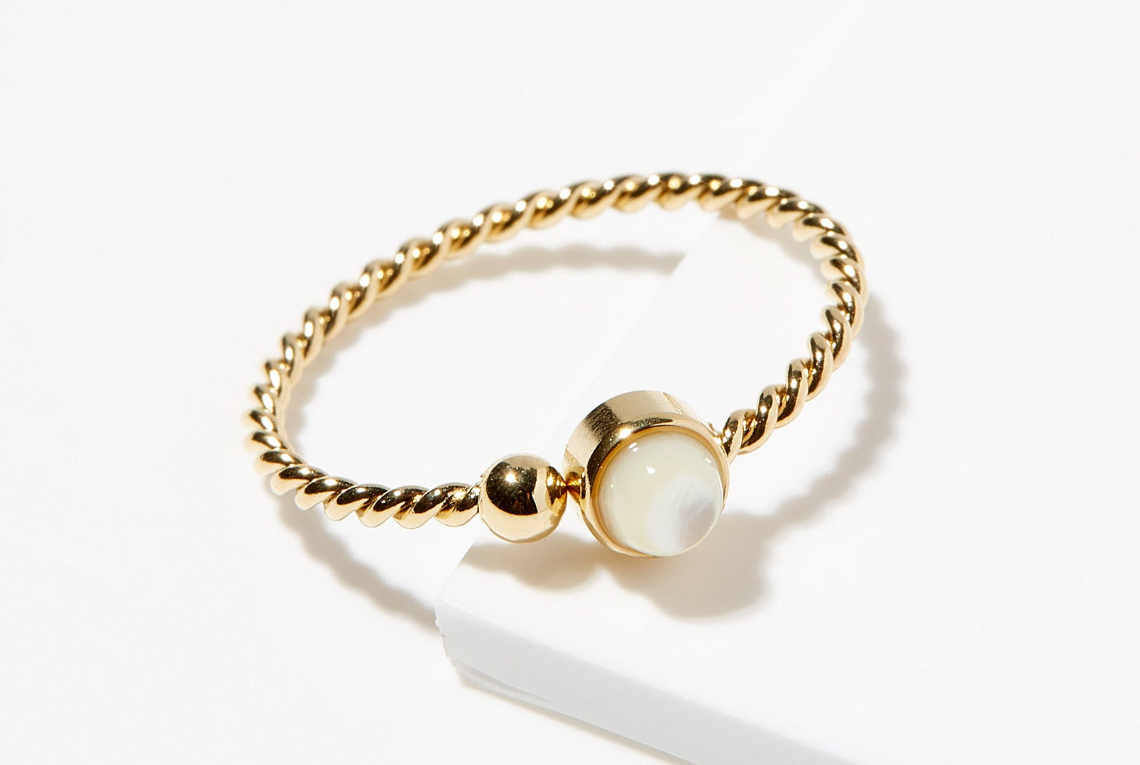 A ring with a pearl stone