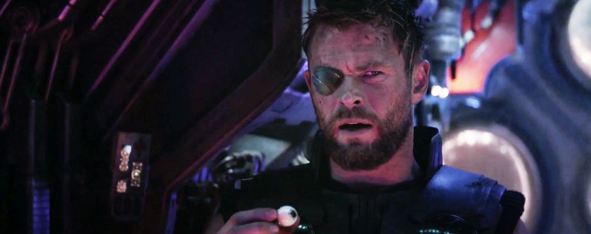 Thor with an eye path on his right eye and holding an eyeball in his hand