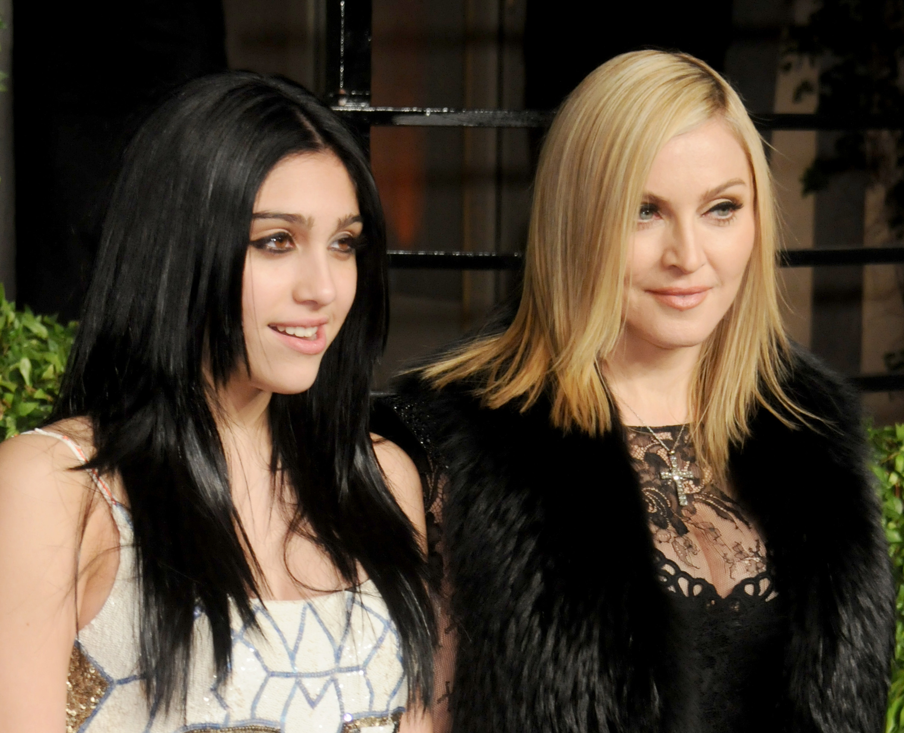 Lourdes Leon and Madonna posing on a red carpet in fancy dresses