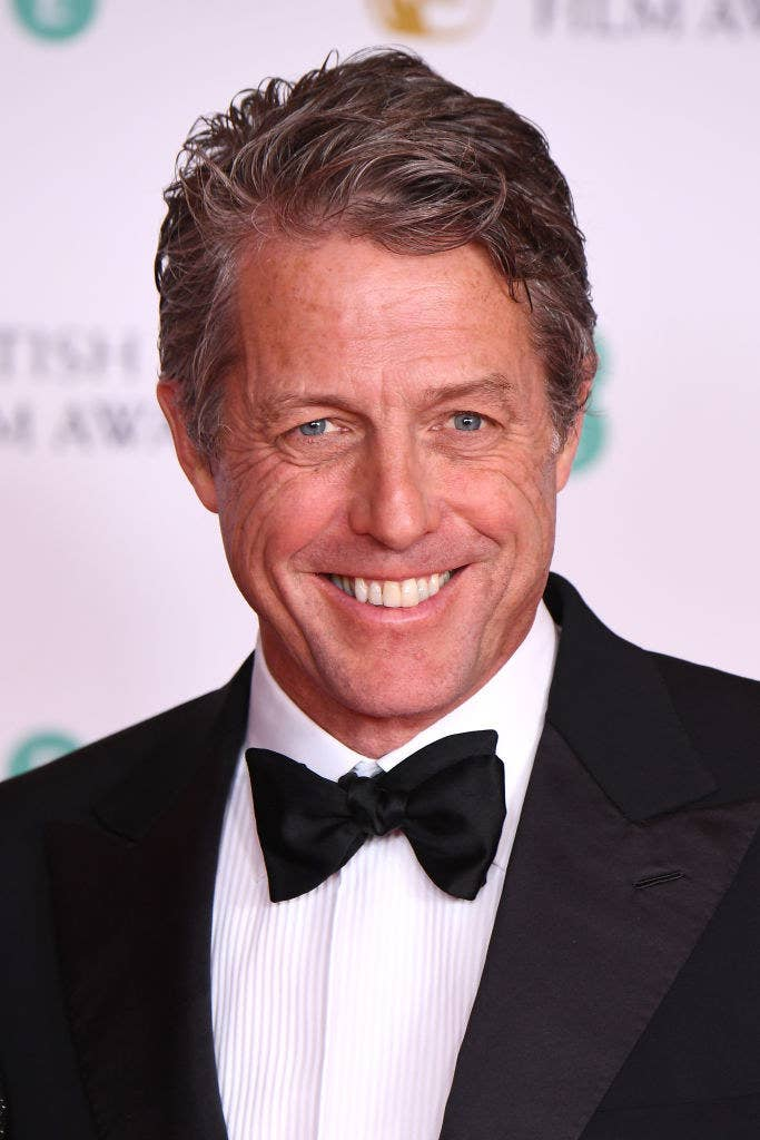 Hugh smiling and wearing a bow-tie