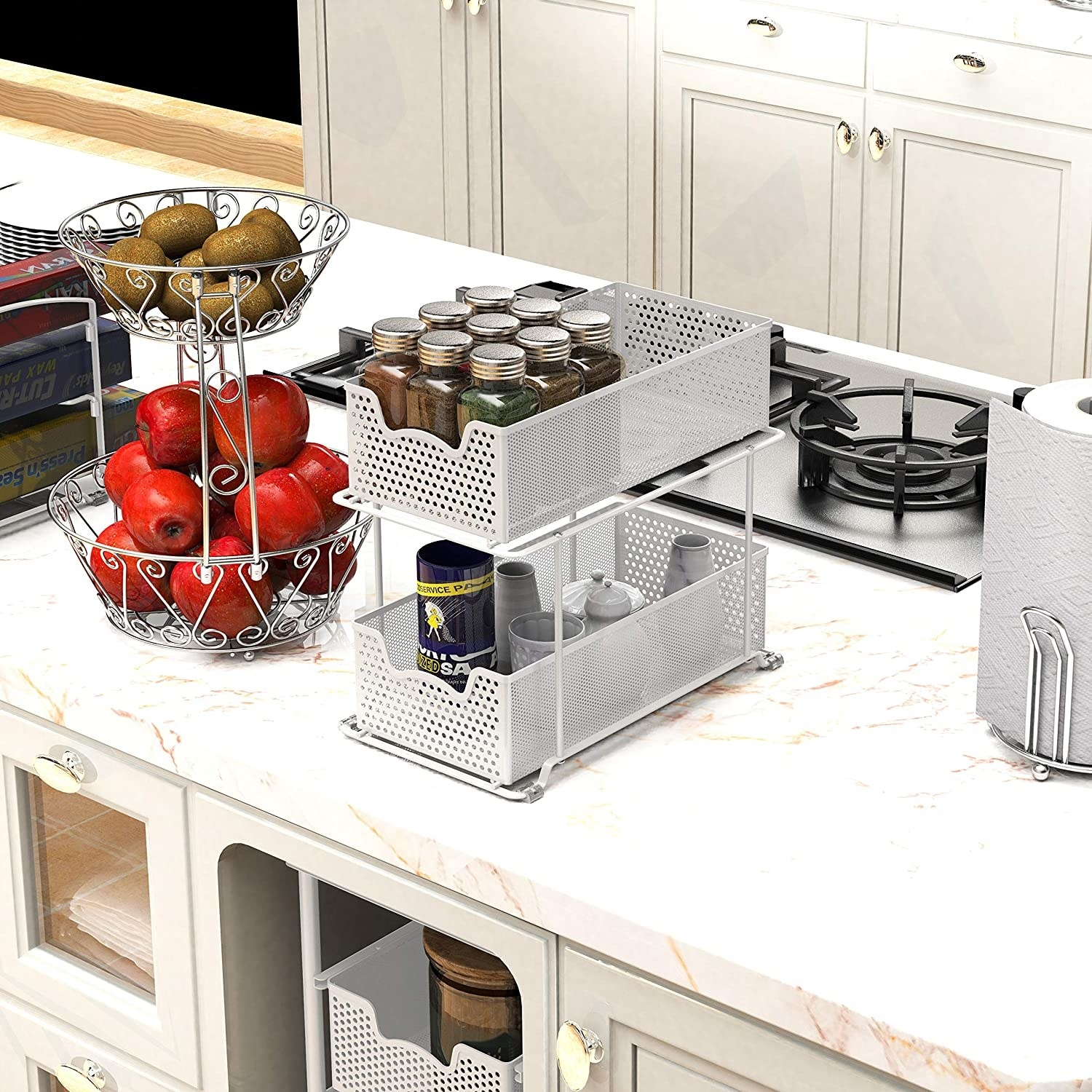 The two-tier set of drawers with spices and kitchen items inside