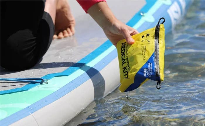 a first aid kit being pulled out of the water