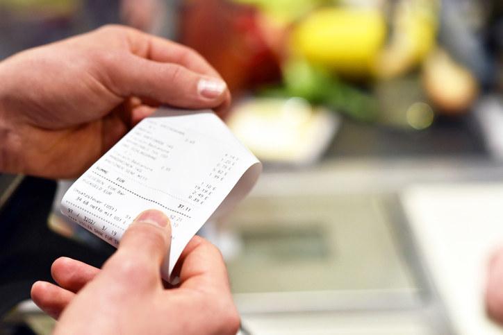 holding a receipt