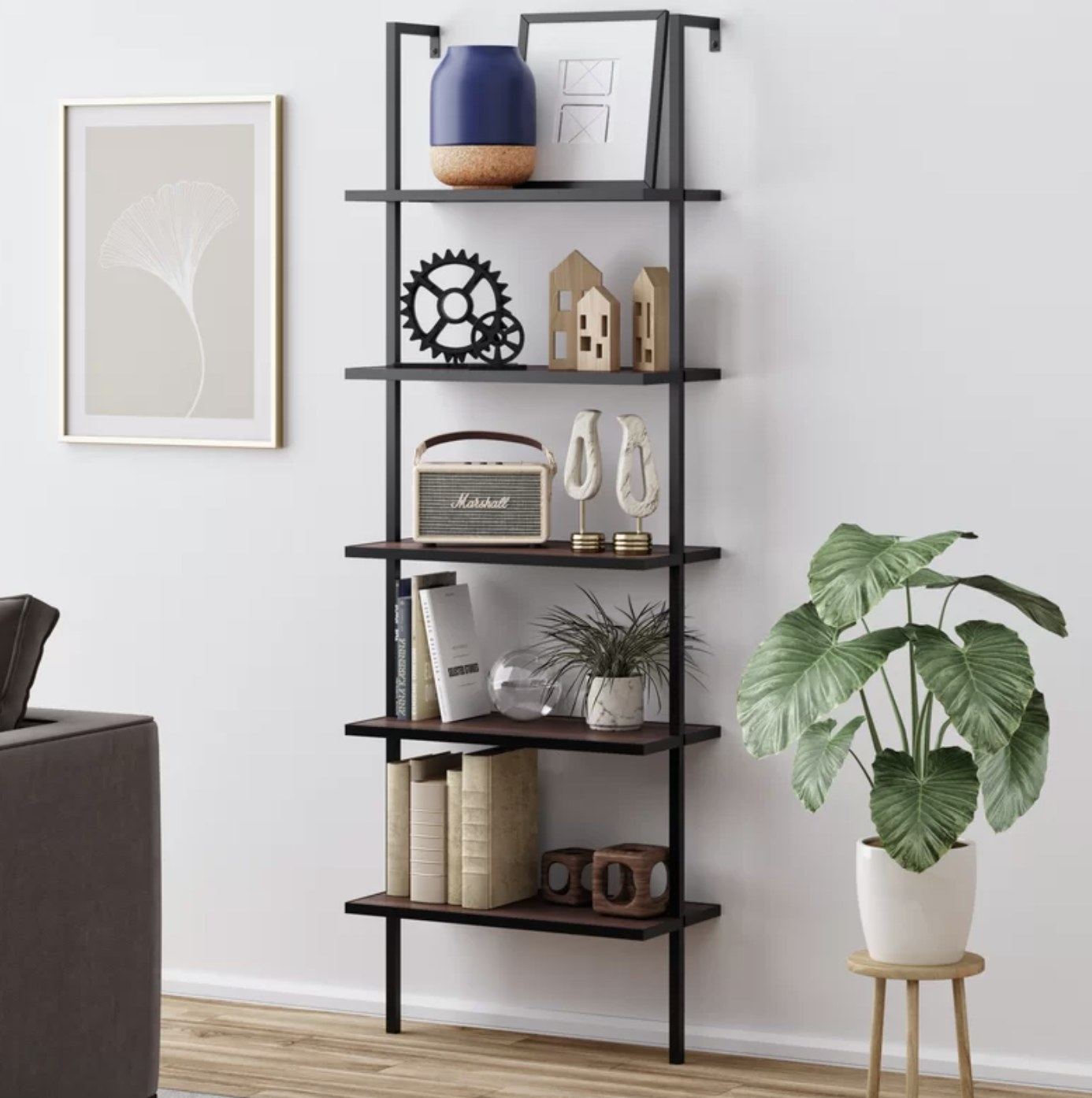 the bookcase in black filled with trinkets and decor