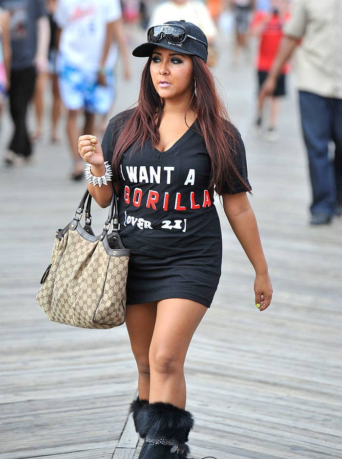 """Snooki wearing a shirtdress that says """"I want a Gorilla Juicehead"""""""
