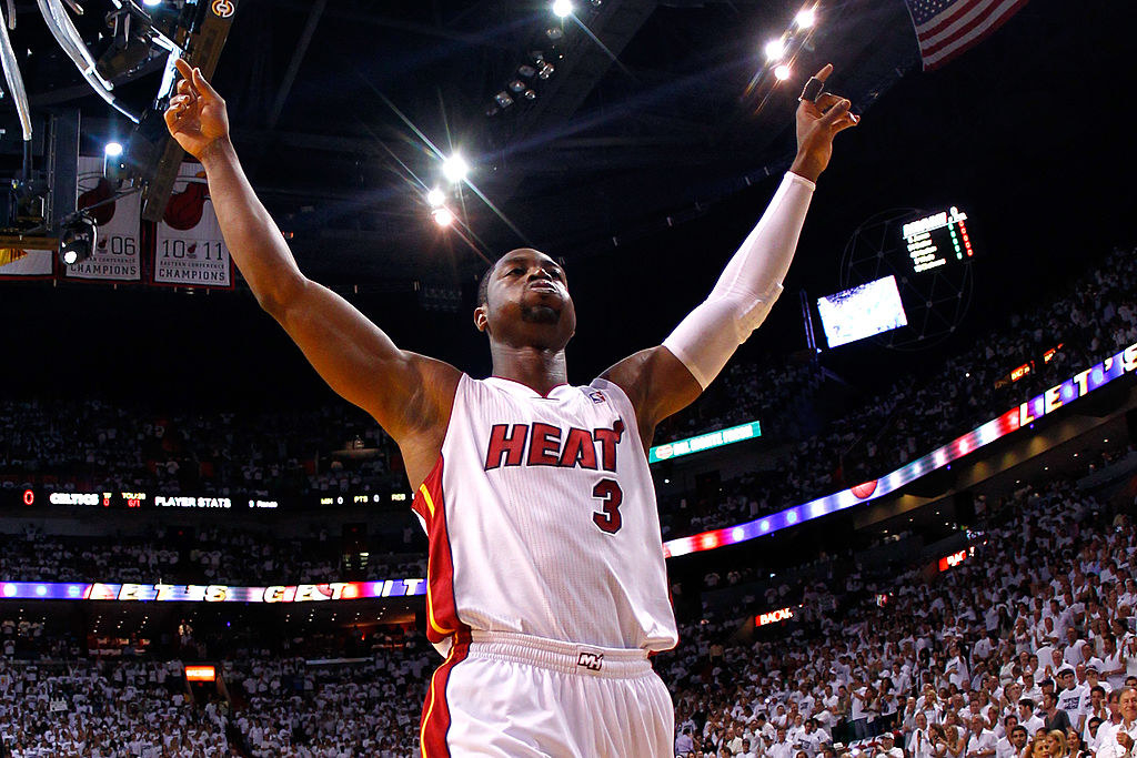 Dwyane raising his arms at a basketball game when he played for the Miami Heat