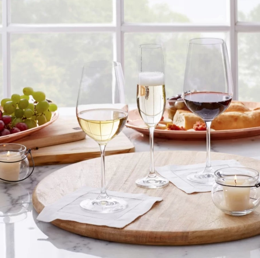 A champagne and wine glass that makes up the 36-piece set displayed on a lazy susan