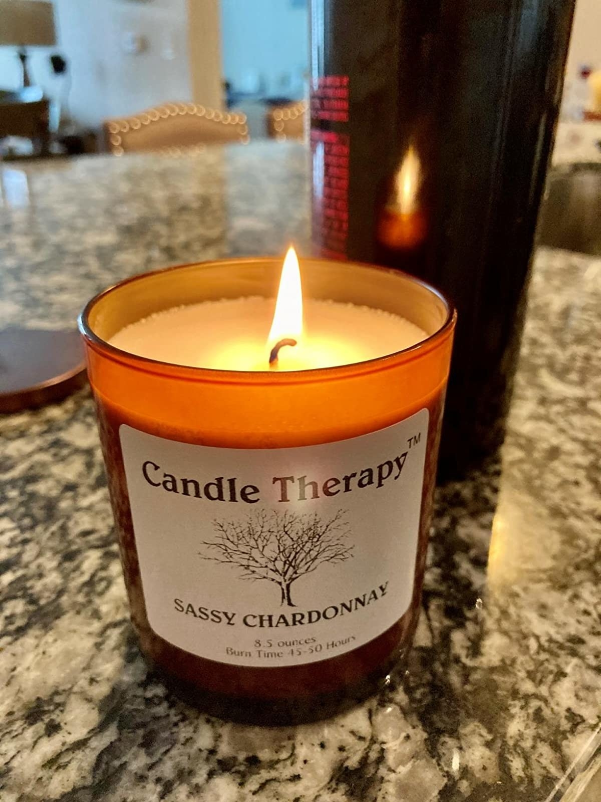 reviewer image of their sassy chardonnay candle burning