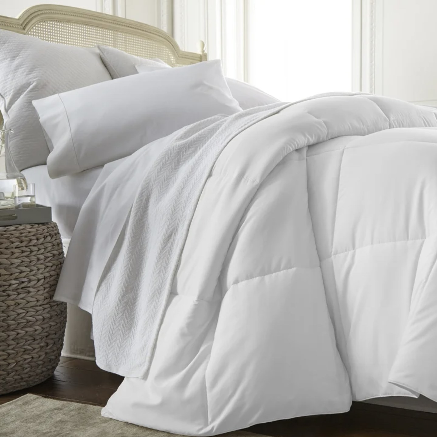 The white comforter set on a bed
