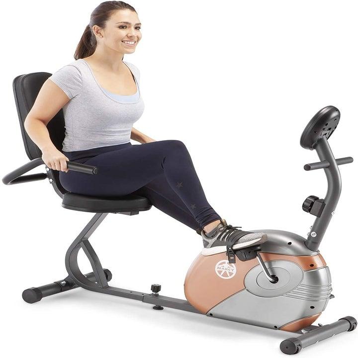 model sits in same type of bike