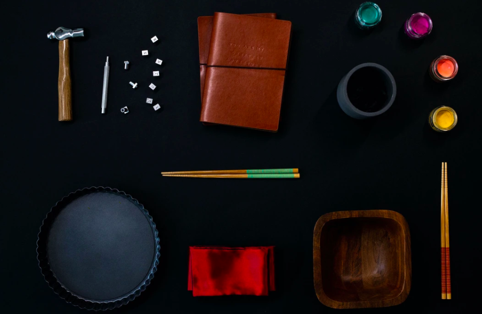 paints, chopsticks, two leather books, a hammer and nails, and other objects