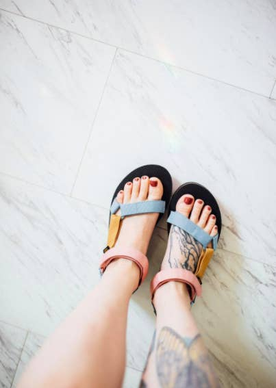 a reviewer wearing the sandals