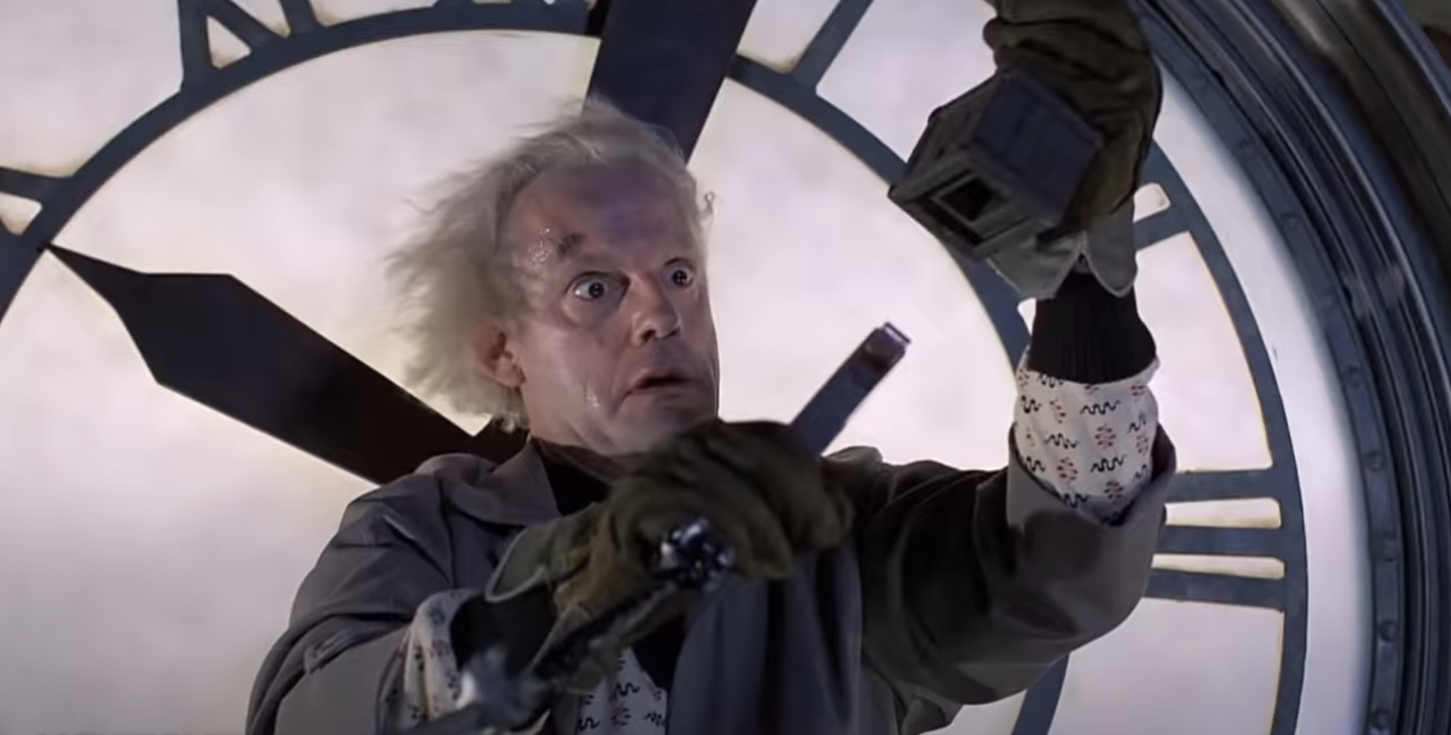 Doc standing on the clock tower