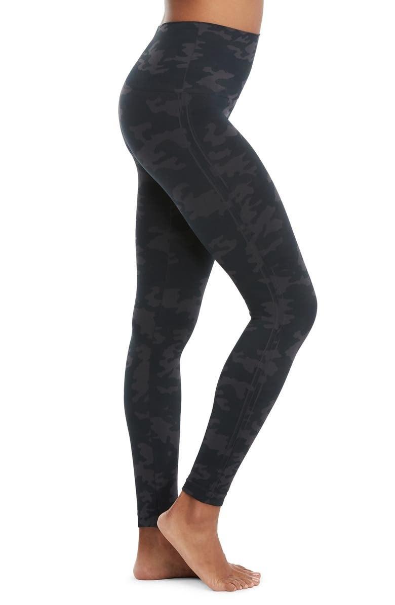 A model wears the leggings in black camo