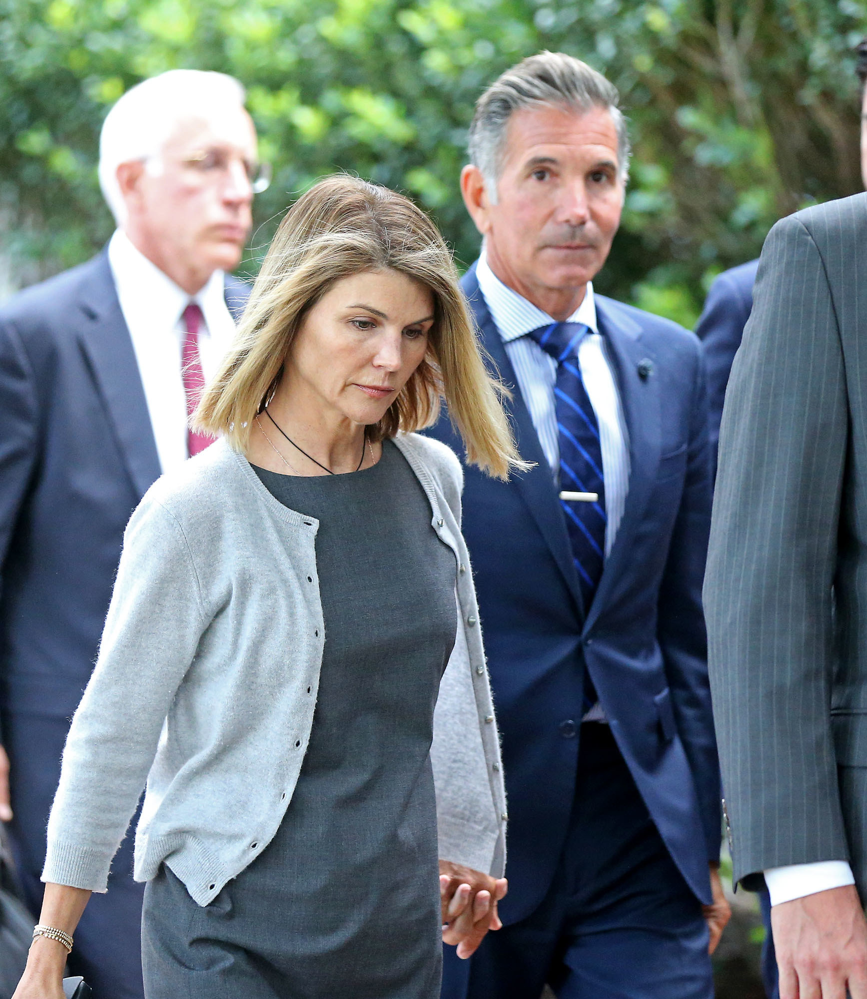 Lori Loughlin and Mossimo Giannulli leave Moakley Federal Courthouse in August 2019