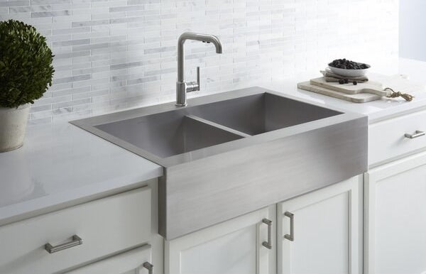 The stainless steel sink in a kitchen